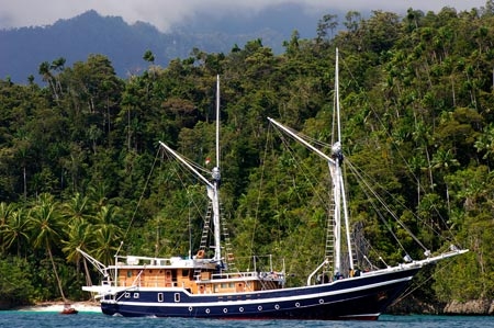 MSY Seahorse Liveaboard anchored at island in Indonesia